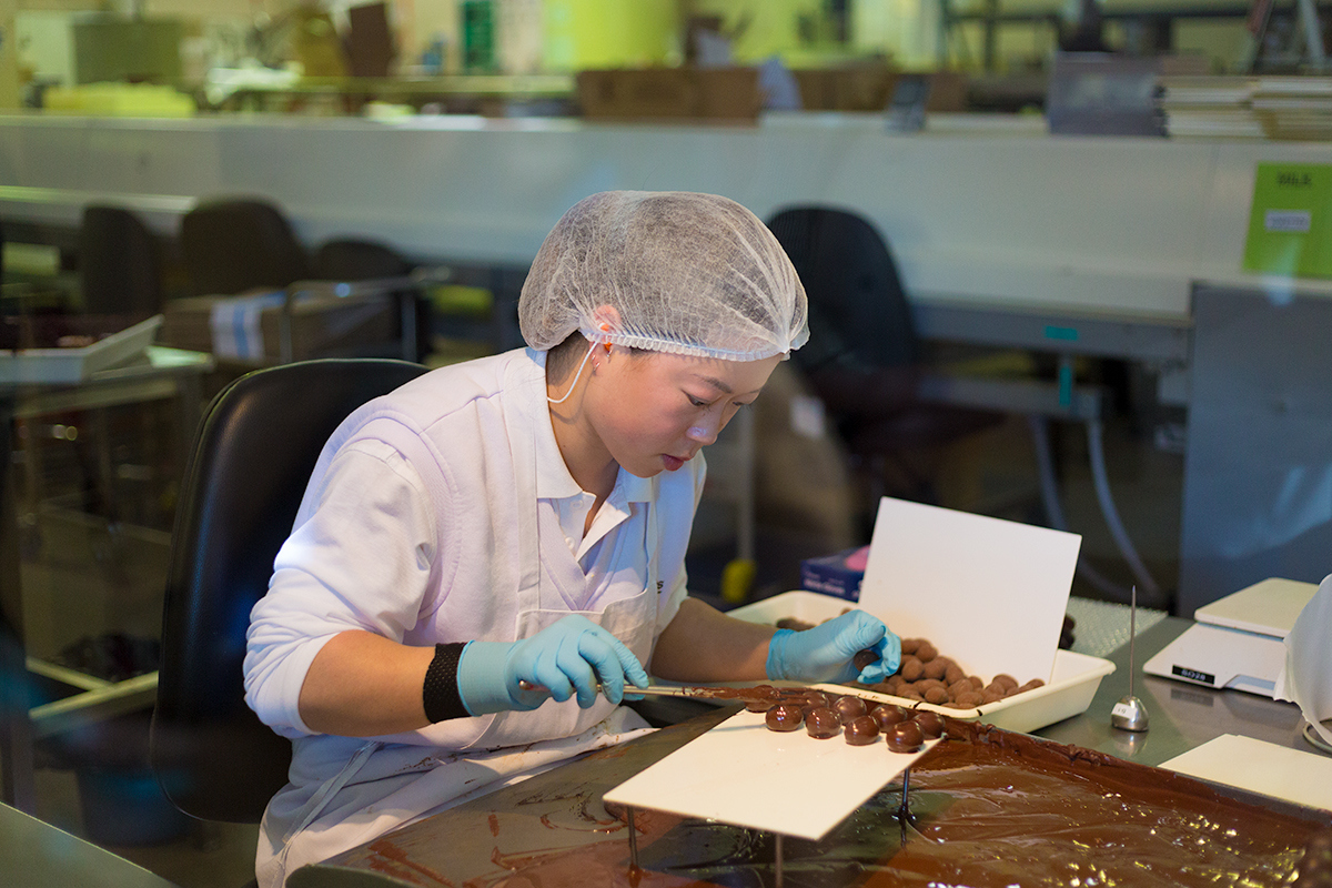 Meticulously crafting the perfect chocolate covered almond, Haighs Chocolate Factory